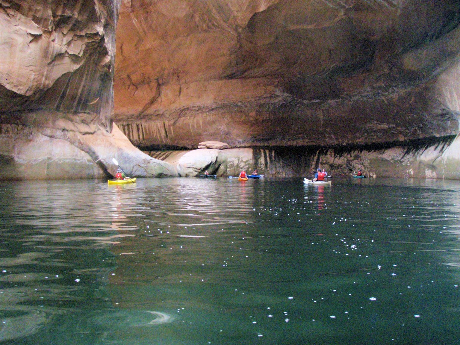 Kayaking into one of Lake Powell's many canyons